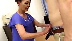 Asian granny with large tits sucks on young African Johnny hard