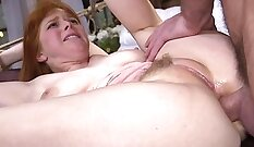 Anna gets her pretty red head hips and butt bent over to suck cock