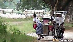 Asian schoolgirl giving head outdoors
